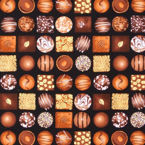 Patchworkstoff Chocoholic Süsses Pralinen auf Schwarz